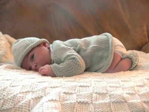{wearing his cozy layette set}